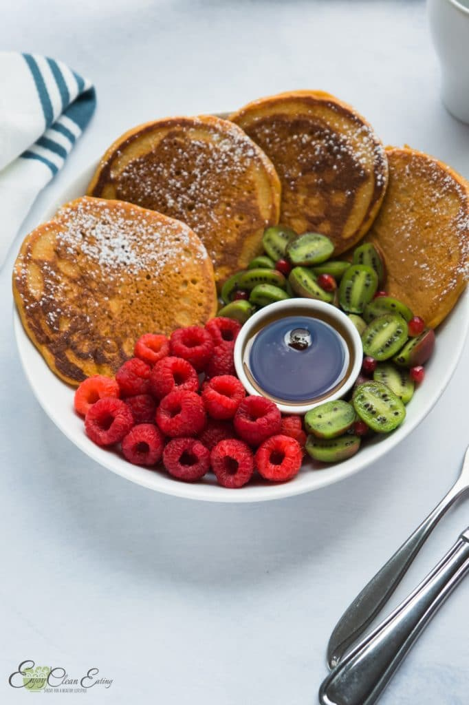 pumpkin pancakes with fresh fruits and pure maple syrup