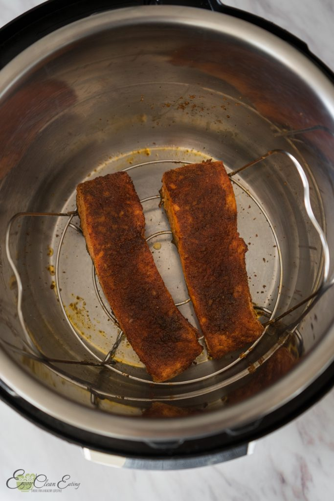 Fish inside the instant pot inner pot on top of the trivet after air frying