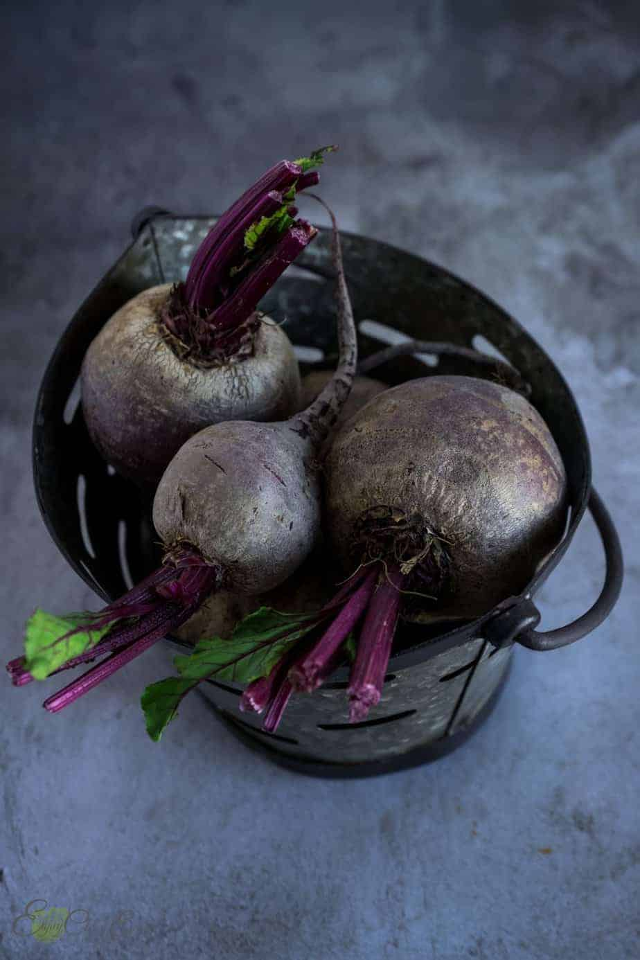 beetroots raw in a small metal basket before cooking.