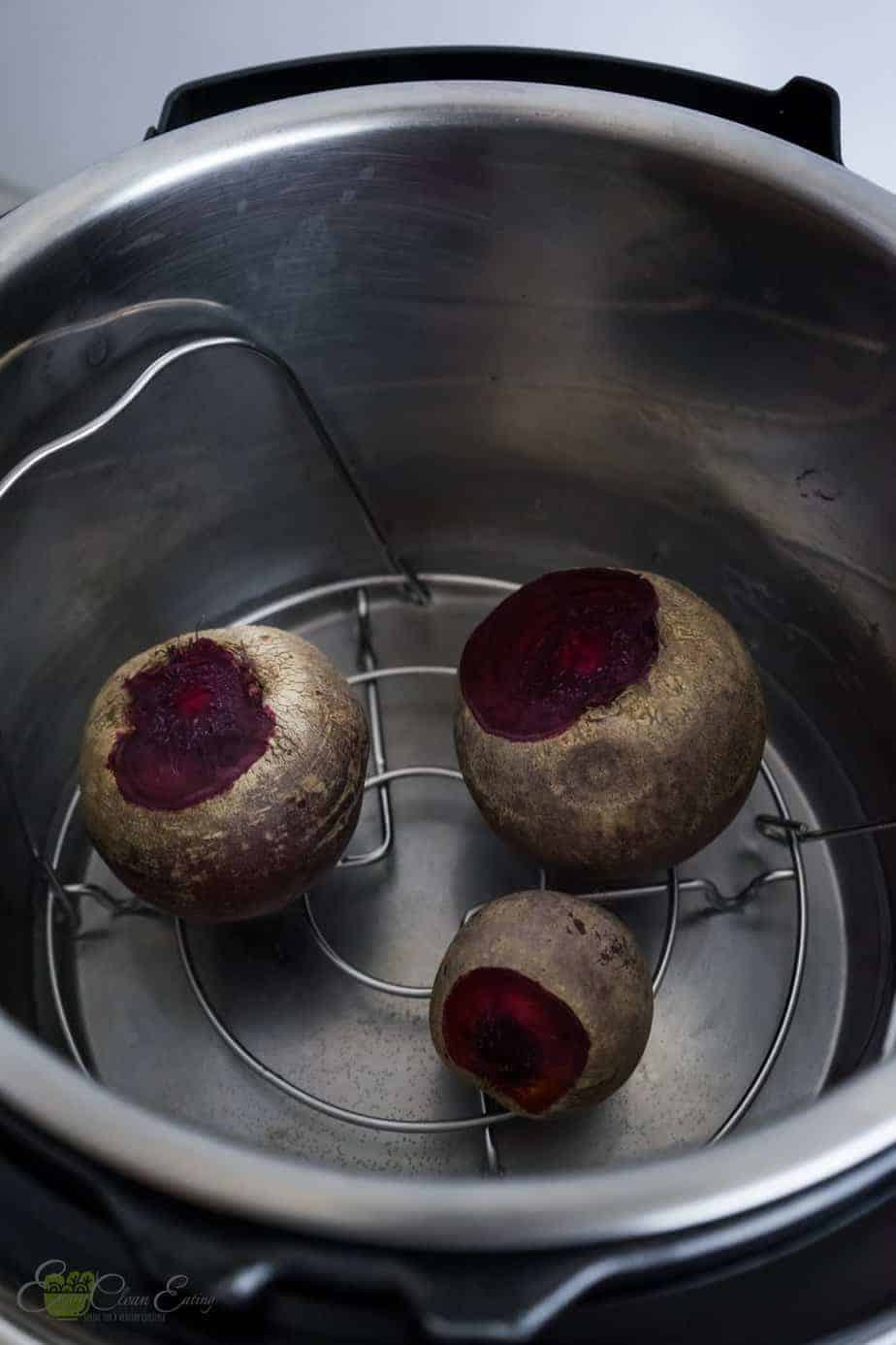 raw beets inside the pressure cooker with water before cooking.