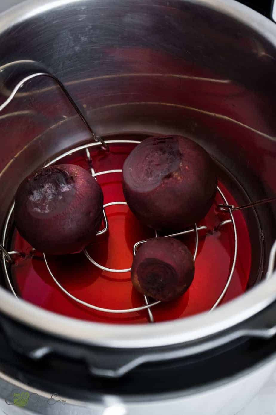 beets inside the instant pot after pressure cooking them, the water is stained with red color.
