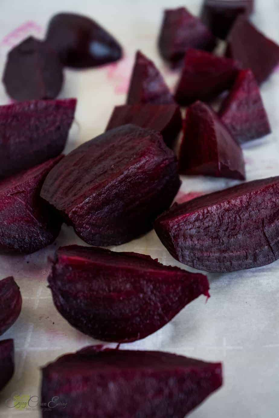 Steamed beets cut, spread on a cutting board