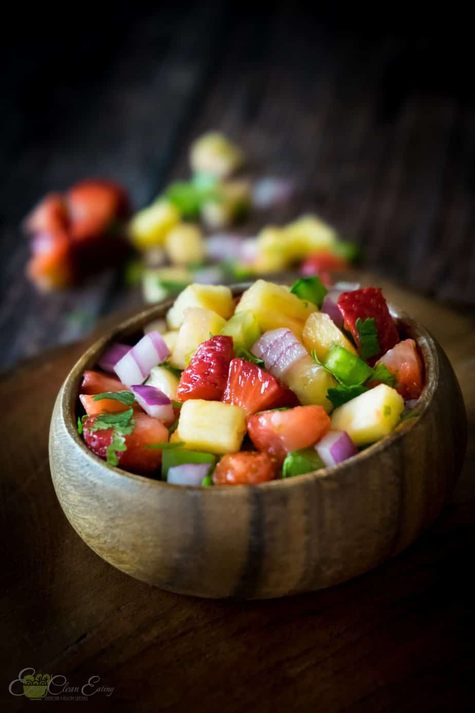 serve salad in a small wooden bowl with beautiful vibrant colors