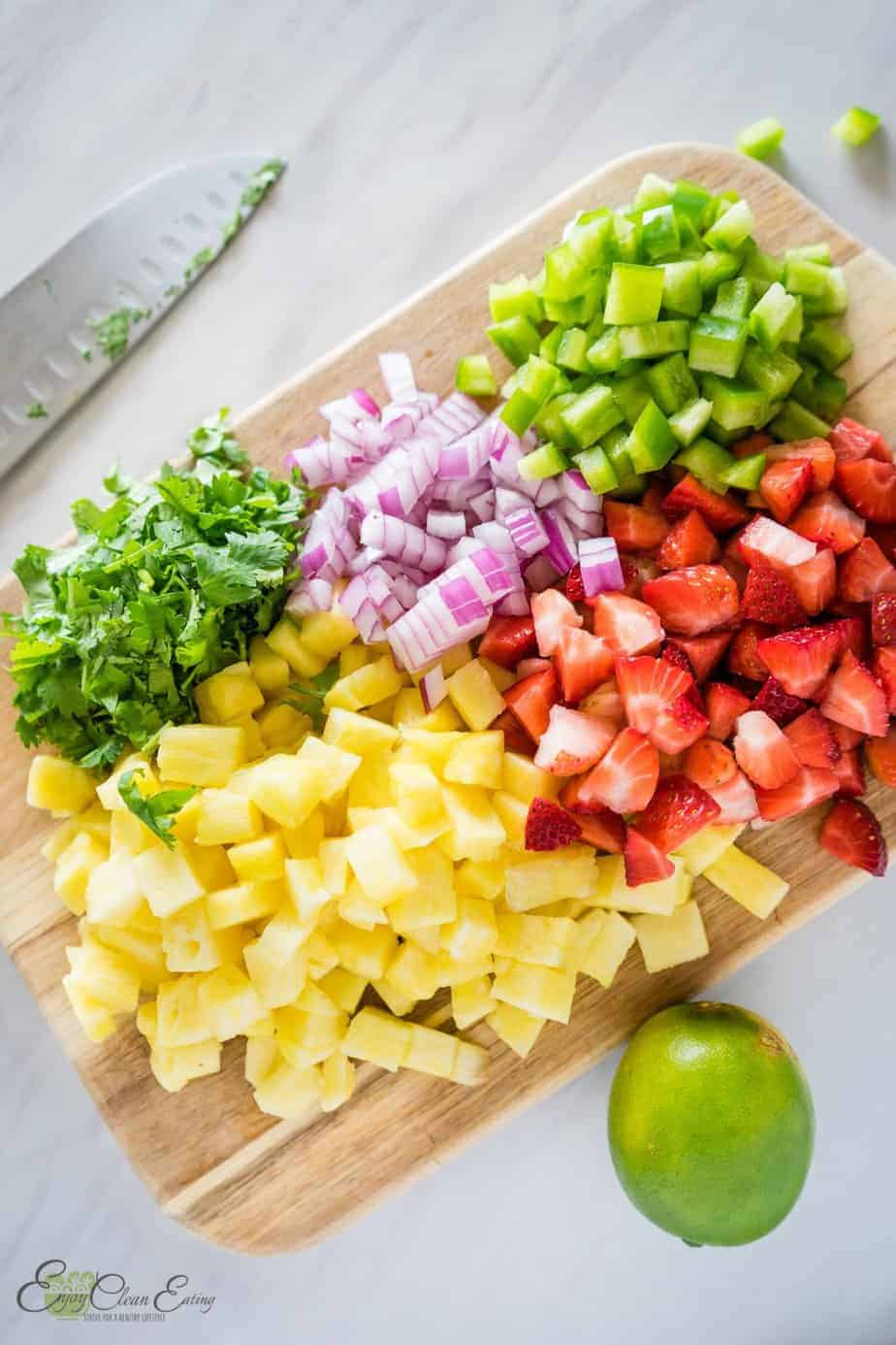 diced fruits and vegetables to make strawberry pineapple salsa