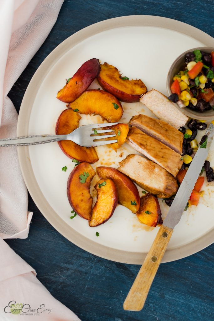 slices of air fryer pork chops with a little mess plate while eating the peaches and black beans corn salsa