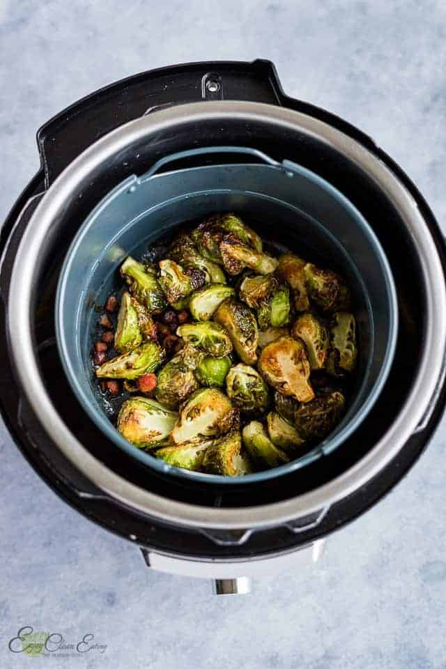 fully cooked sprouts in the basket and the instant pot.