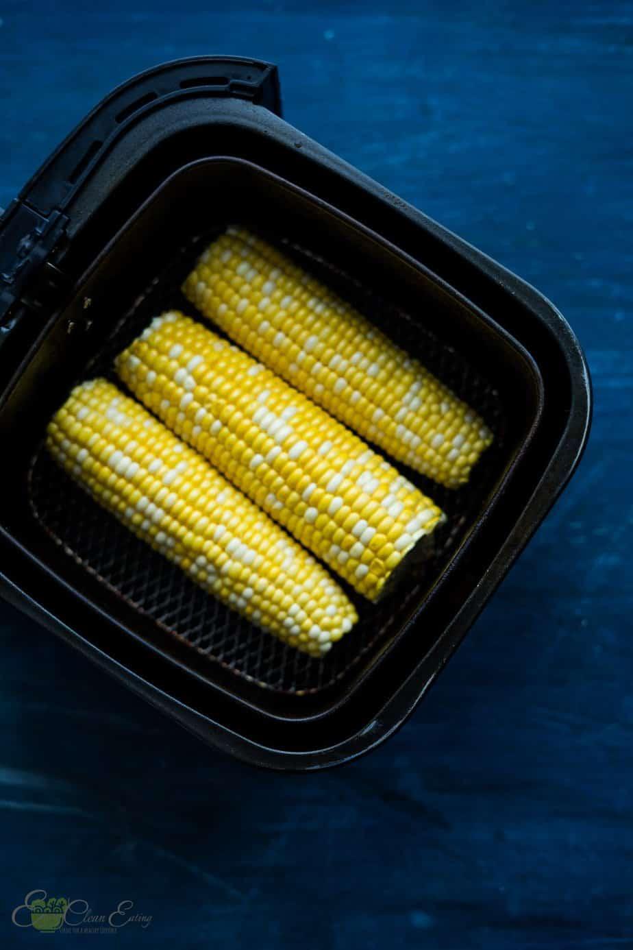corn on the corn inside the air fryer basket