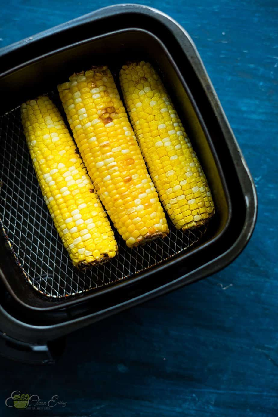 perfectly cooked corn on the corn inside the air fryer basket