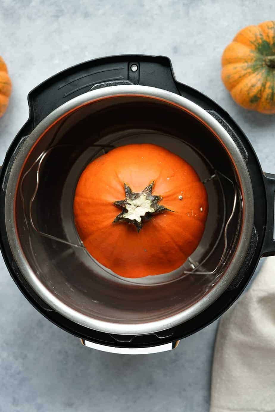 Raw pumpkin inside the instant pot to be steam.