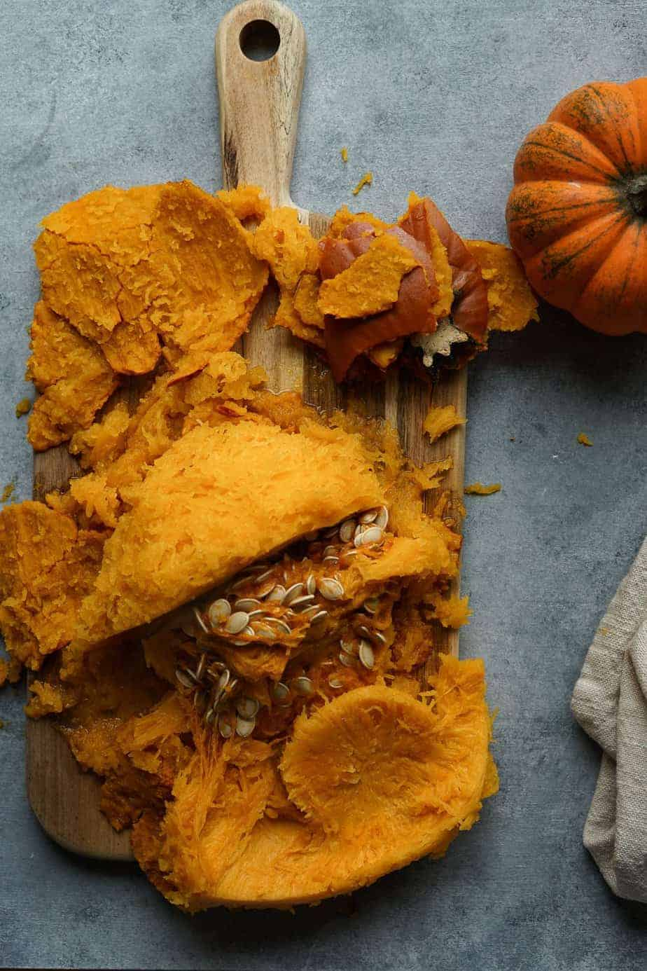 Once the skin is removed cut the pumpkin in the cutting board and start to remove the seeds