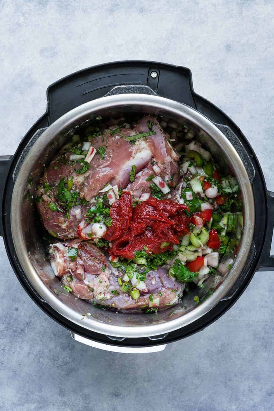 Adding the turkey thighs with the ingredients in the instant pot