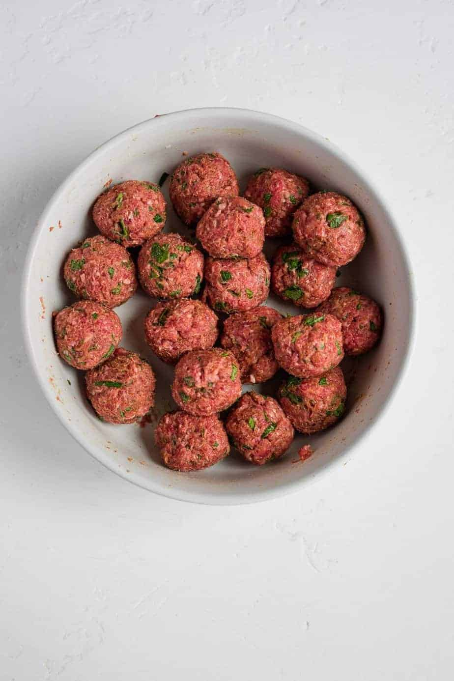 the ground lamb and all the ingredients into balls