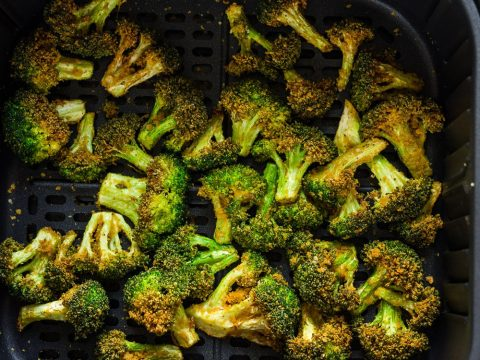 crispy air fryer broccoli inside the air fryer basket