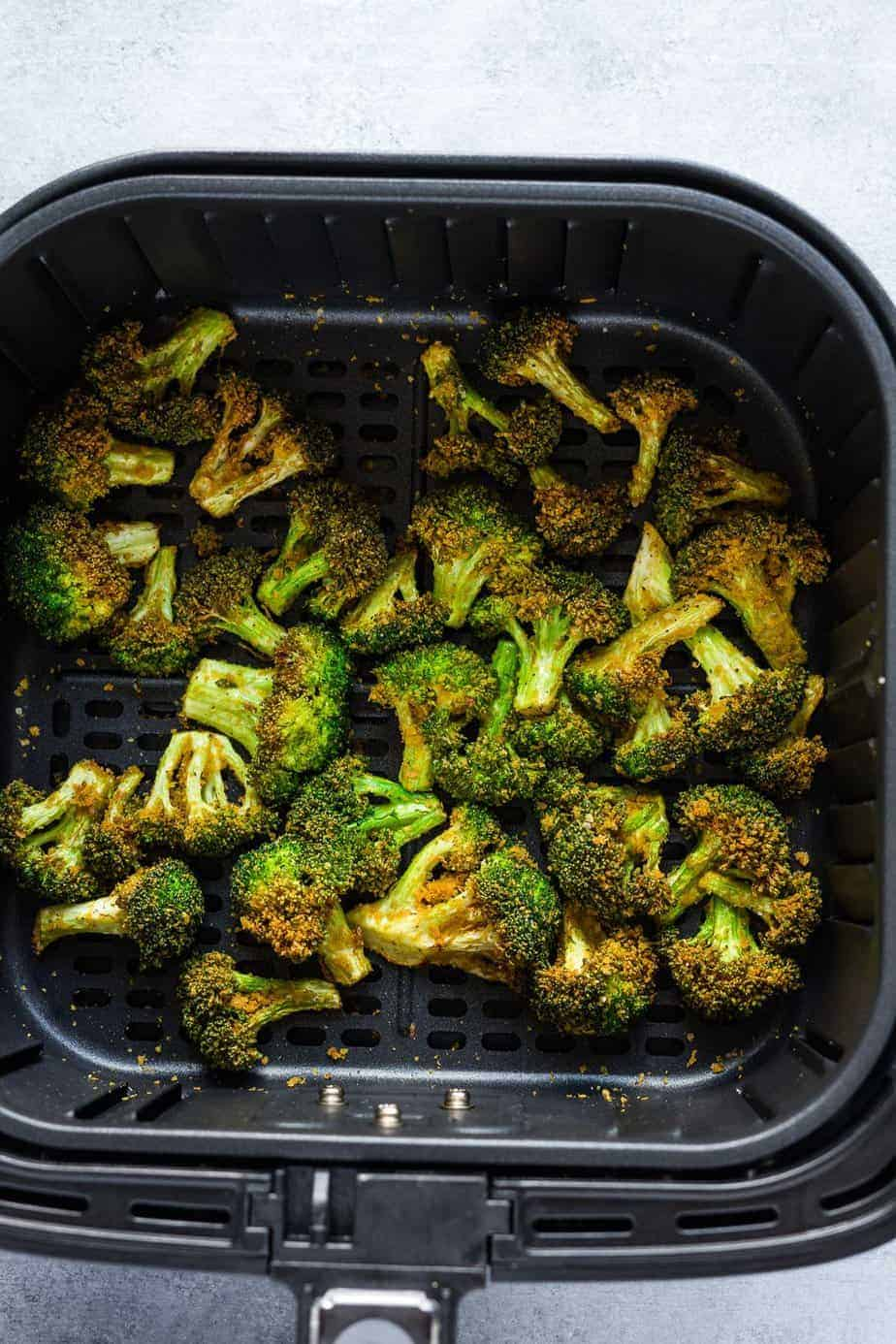 crispy air fryer broccoli inside the air fryer basket