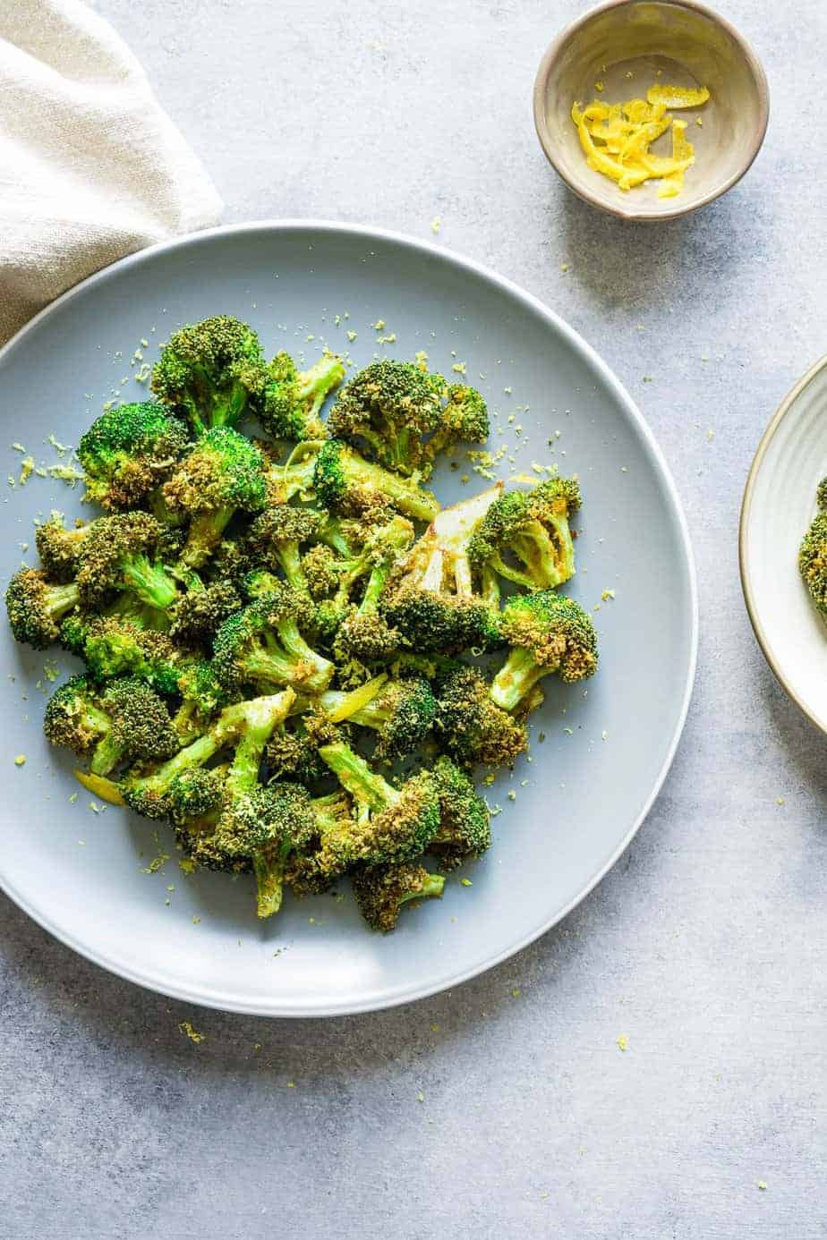 Crispy air fried broccoli sprinkle with lemon zest