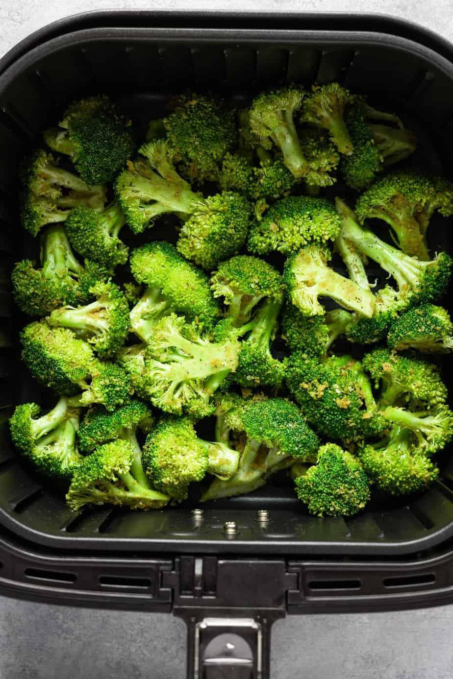 arranged broccoli inside the air fryer basket