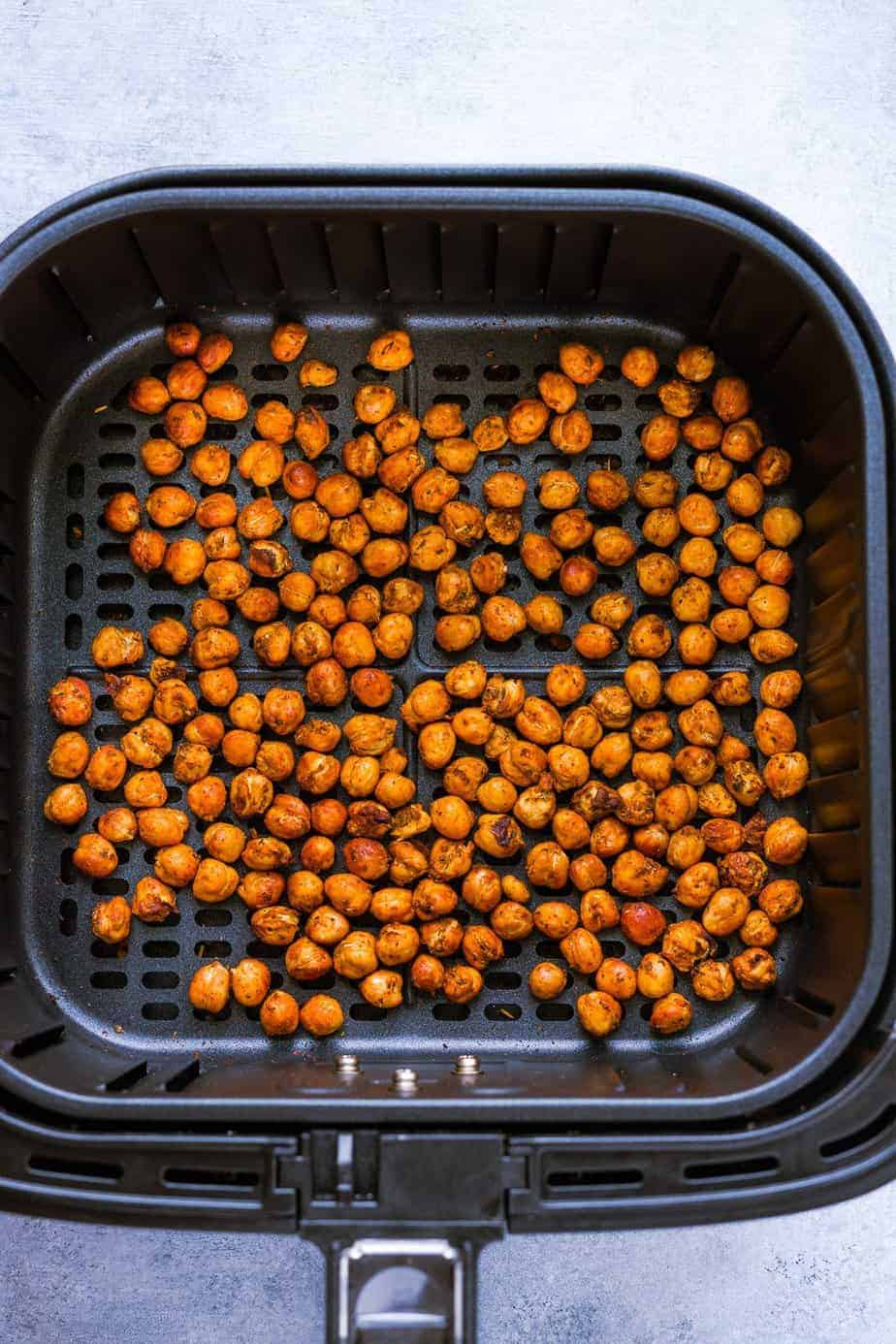 chickpeas in air fryer basket after cooking