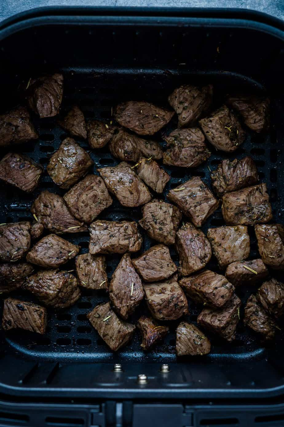 During the process of air fryer the steak bites.