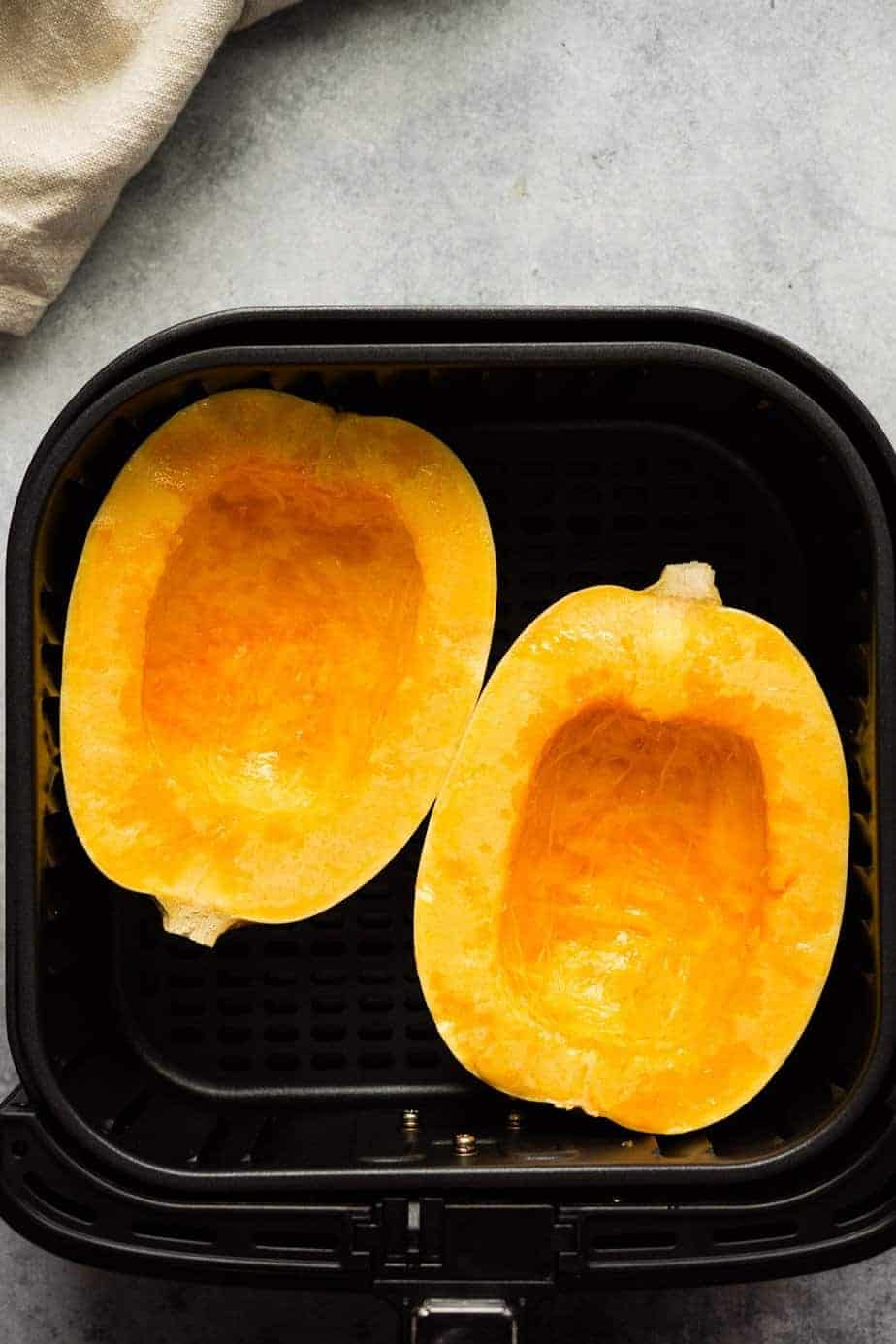 spaghetti squash inside the air fryer basket