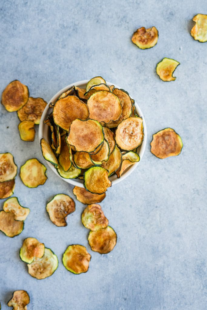 crunchy zucchini chips in a bowl.