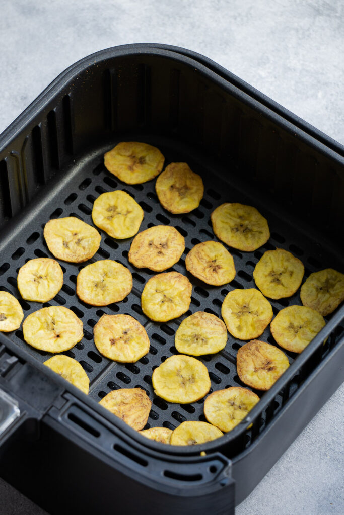 After cooking the plantains slices in the air fryer basket.