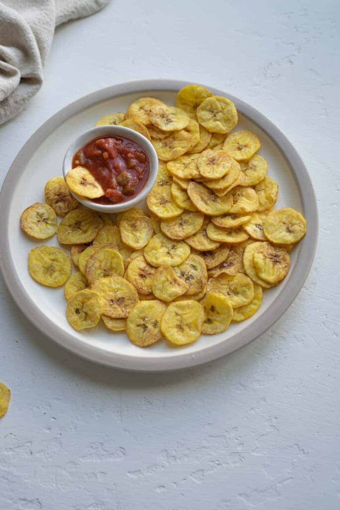 homemade plantain chips serve with dipping sauce.