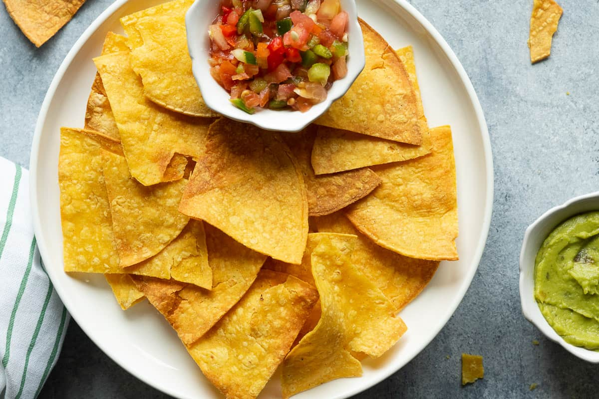 air fryer tortilla chips serve with salsa and guacamole.