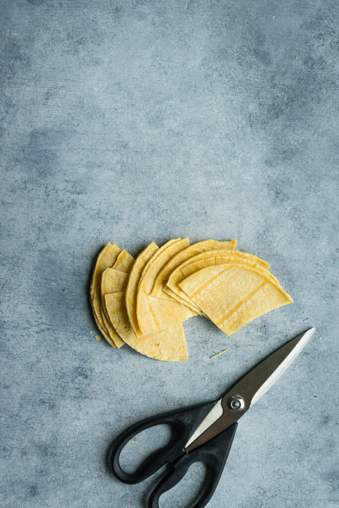 Cut corn tortillas into triangle to make chips in the air fryer.