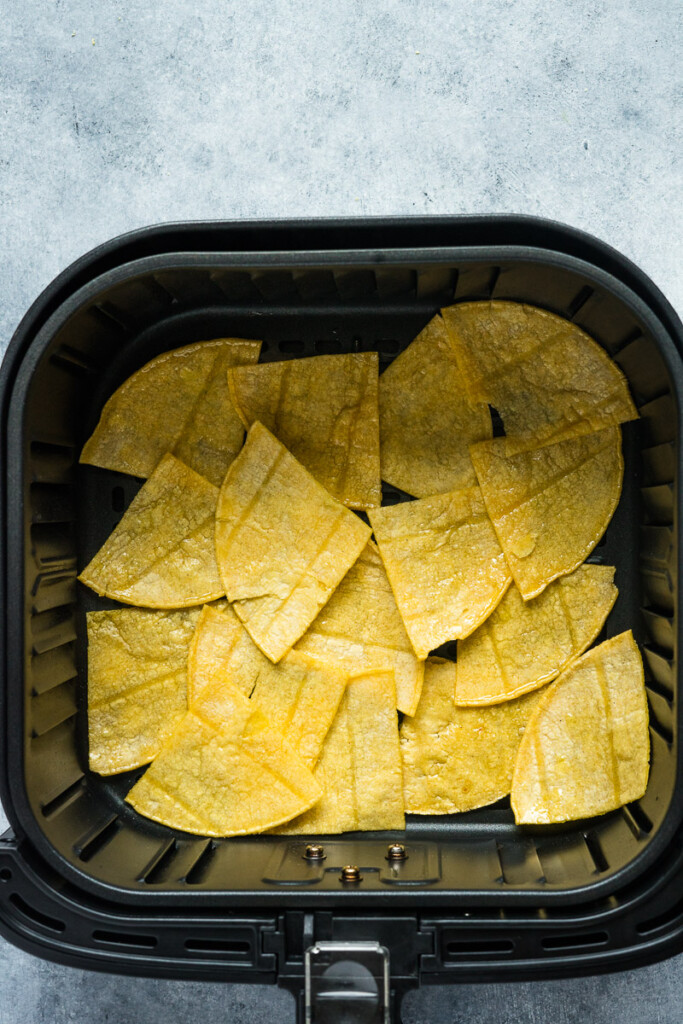 Cut tortillas inside the air fryer basket before cooking.