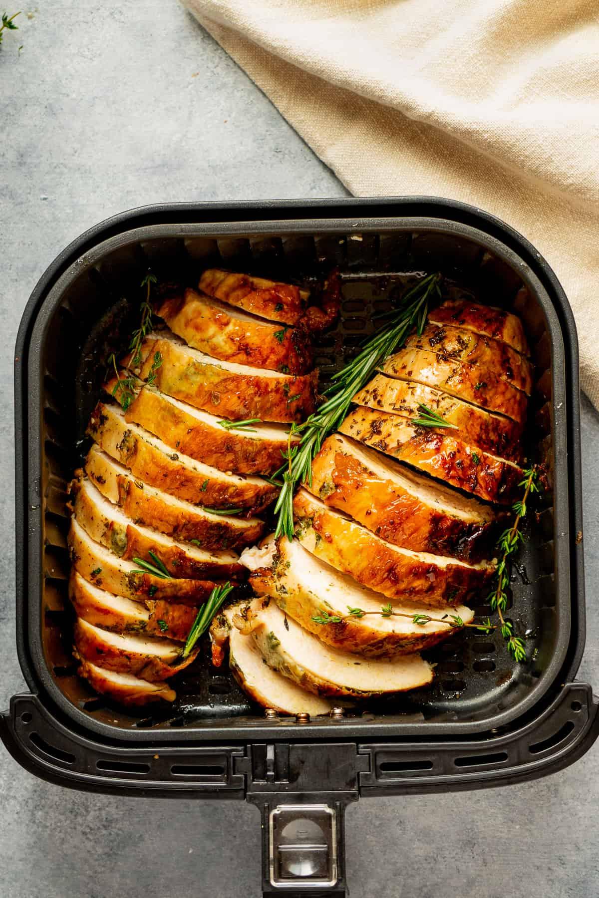 Juicy sliced turkey breast in the air fryer basket.